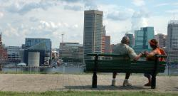 Black couple looking out at Baltimore waterfront