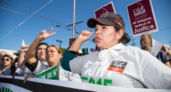 Latina Fight for $15 protestors at rally