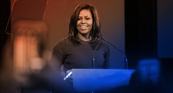Michelle Obama speaking at a podium