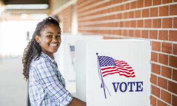 Young woman at voting booth