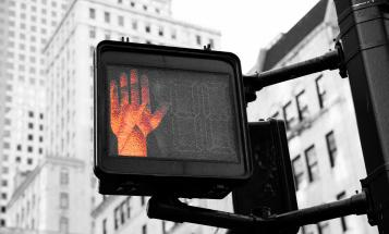 Don't cross orange hand on a cross walk sign
