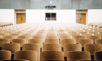 Empty chairs in a college classroom