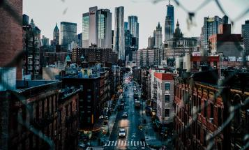 View of a New York street and buildings through chain link fence