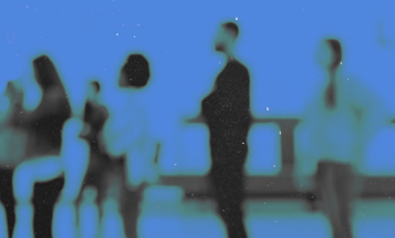 Blurry blue image of people standing in line