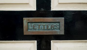 Mail slot labeled letters