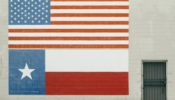 US Flag and Texas Flag Painted on big brick wall