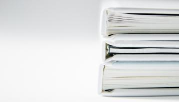 Stack of white notebooks