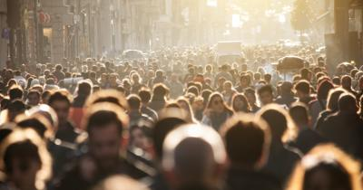 Crowd in the street with golden sunlight