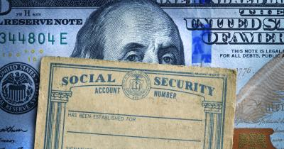 Federal reserve note behind social security card