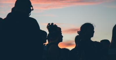 Group of people backlit at sunset