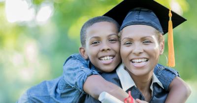 Black woman graduate and son
