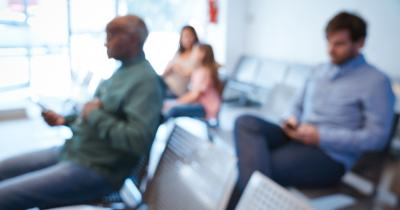 Defocused image of people sitting in an agency waiting room
