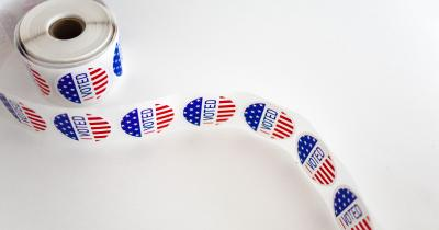 Roll of I Voted Stickers on white table