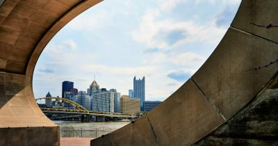 Pittsburgh skyline seen through the Fred Rogers Memorial Monument in foreground