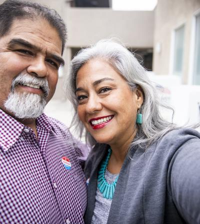 Smiling Latino couple who just voted