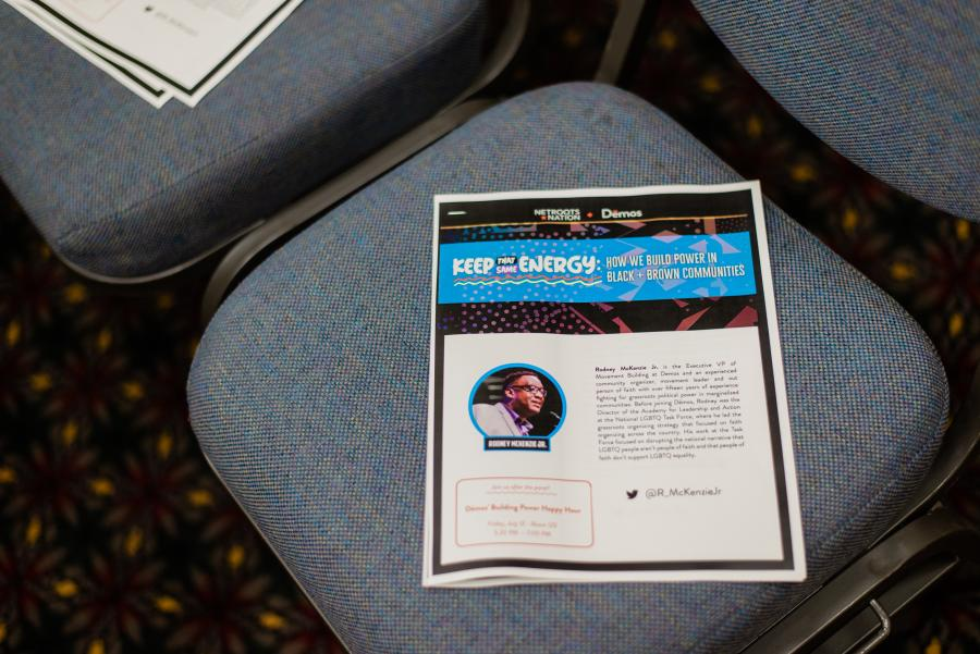 A Keep That Same Energy handout on a chair at Netroots